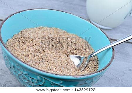 Bran in ceramic bowl on wooden table