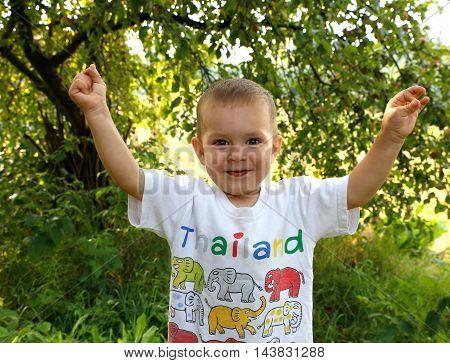 joyful boy playing in the garden for micro-stock