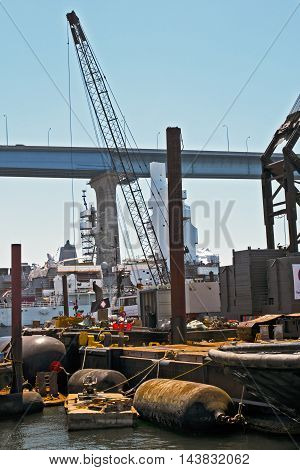 Seaport Tower Crane In Front Of Bridge And Floating Fenders