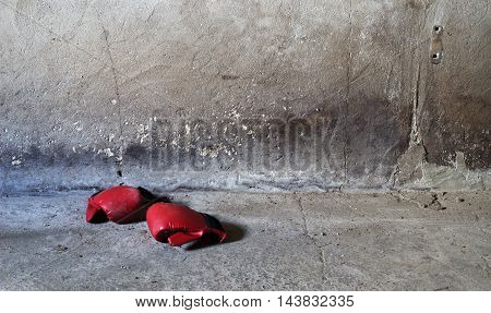 Boxing cloves on a dirty concrete floor