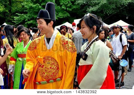 New York City - August 15 2011: Smiling Asian couple wearing traditional Korean ceremonial clothing at the Korea Day 2011 Festival on the Mall in Central Park