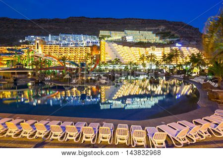 TAURITO, GRAN CANARIA, SPAIN - APRIL 23, 2016: Aquapark and resort complex in Taurito at night, Gran Canaria island, Spain. Taurito is very popular tourist destination on Gran Canaria.