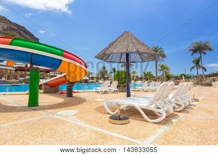 TAURITO, GRAN CANARIA, SPAIN - APRIL 25, 2016: Tourists on sun holidays at the Lago Taurito aquapark in Taurito, Gran Canaria. Taurito is very popular tourist destination