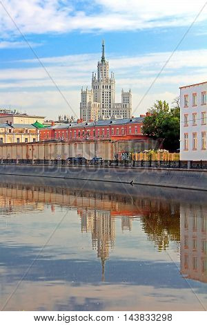 Stalin's Empire style building and reflection in the water in Moscow, Russia