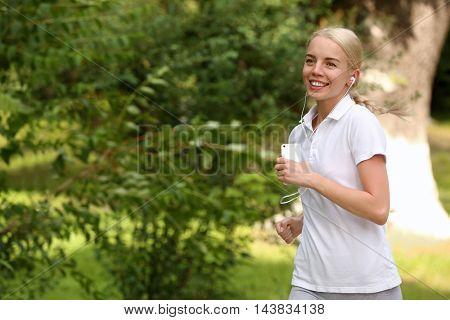 Beautiful girl running in spring park