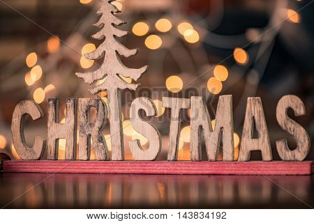 Christmas text against bokeh background