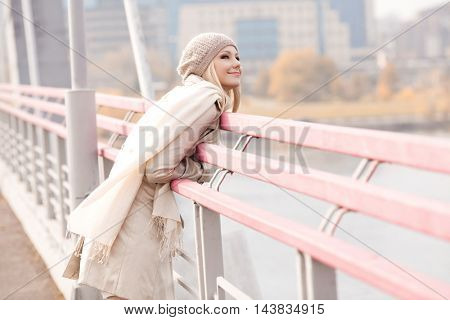 happy young blond woman on the bridge