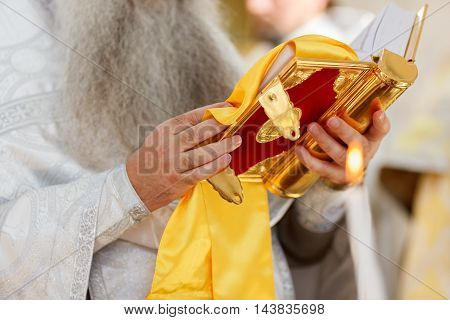 Bible in the hands of an Orthodox priest. Soft focus selective focus