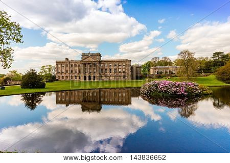 Facade of the historic Lyme Hall and park in Cheshire, England.