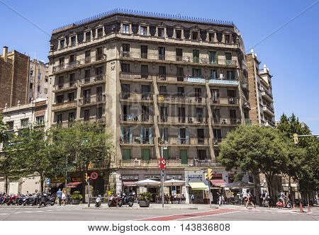 BARCELONA SPAIN - JULY 5 2016: Architecture along Carrer de la Marina street in Barcelona Spain