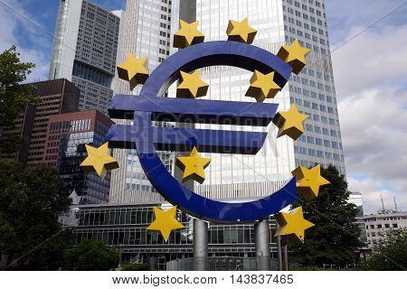 FRANKFURT, GERMANY - AUGUST 22, 2016: Euro monument in front of European Central Bank in Frankfurt's finance and banking area.