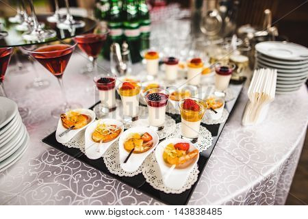 Dessert with jelly pudding and berries. Holiday food concept