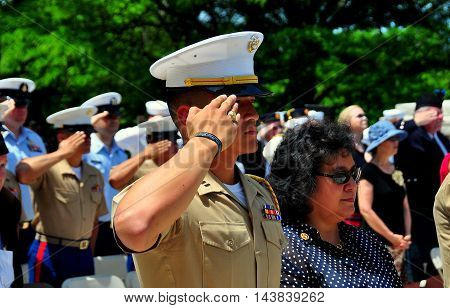New York City - May 26 2014: United States Marine saluting during the Memorial Day Remembrance ceremonies in Riverside Park *