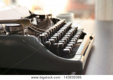 Old typewriter on the table, closeup