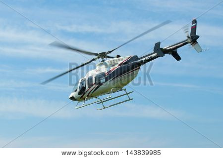ST. PETERSBURG, RUSSIA - MAY 22, 2016: Flying a helicopter Bell 407GX (RA-01605) close-up