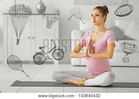 Beautiful pregnant woman sitting in lotus pose on mat at home. Sport lifestyle concept. Diversity of sport icons on background.