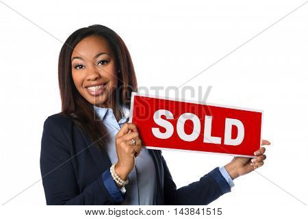 Portrait of African American woman holding sold sign isolated over white background