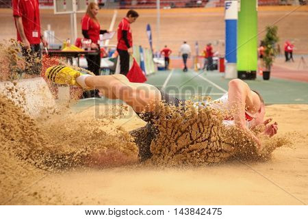 VIENNA, AUSTRIA - JANUARY 31, 2015: Daniel Gardiner (#253 Great Britain) competes in the men's long jump event during an indoor track and field event.