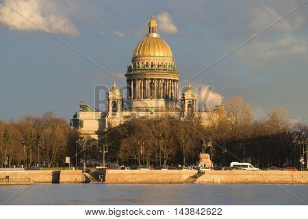 ST. PETERSBURG, RUSSIA - APRIL 23, 2016: The St. Isaac's Cathedral in the light of setting sun of the April evening. Historical landmark of the city Saint Petersburg