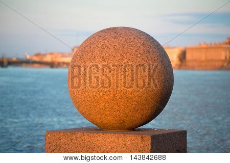 ST. PETERSBURG, RUSSIA - APRIL 23, 2016: Granite ball on the spit of Vasilievsky island in the light of the setting spring sun of the April evening. Historical landmark of the city Saint Petersburg