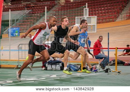 VIENNA, AUSTRIA - JANUARY 31, 2015: Blaz Brulc (#74 Slovenia) competes in the men's 60m event during an indoor track and field event.