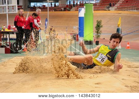 VIENNA, AUSTRIA - JANUARY 31, 2015: Milan Mladenovic (#376 Serbia) competes in the men's long jump event during an indoor track and field event.