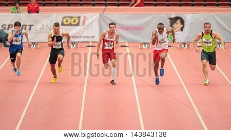 LINZ, AUSTRIA - FEBRUARY 6, 2015: Marvin Popoola (#236 Great Britain) competes in the men's 60m event in an indoor track and field event.