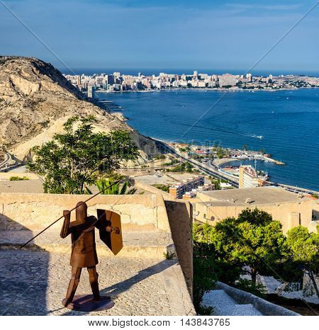 Iron man with spear and shield protecting castle Santa Barbara in Alicante, summer Spain