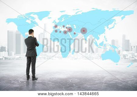 Thoughtful businessman looking at map with targets on abstract city background. Geo targeting concept. 3D Rendering