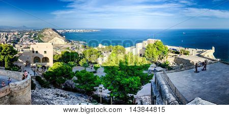 Courtyard of castle Santa Barbara and sea on the horizon, Alicante, summer Spain