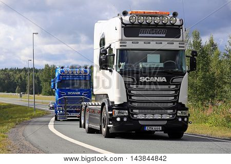 LEMPAALA, FINLAND - AUGUST 11, 2016: White Scania R520 Stream Longline of Puffens Special & krantransporter on the Lempaala motorway junction. The Swedish truck is on the way to participate the annual Power Truck Show 2016.