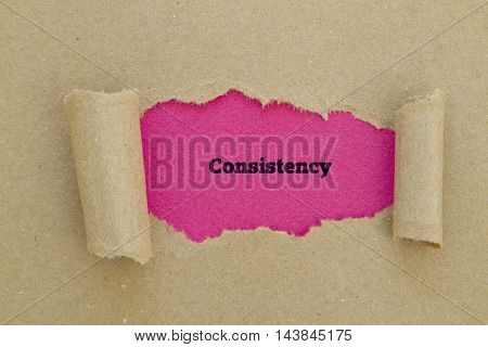 Consistency word written under torn paper .