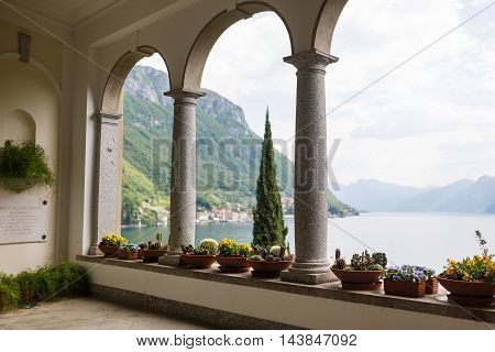 Varenna Italy - May 06 2016: Views of Lake Como through the arch of the Villa Monastero spring time