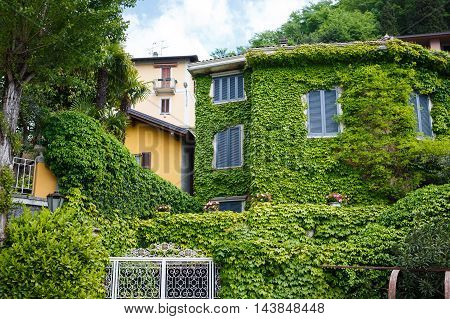 Varenna Italy - May 06 2016: View of the green house in the main pier of the town