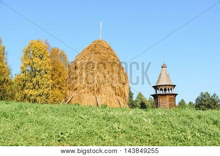 Haystack Of Straw On A Green Grass