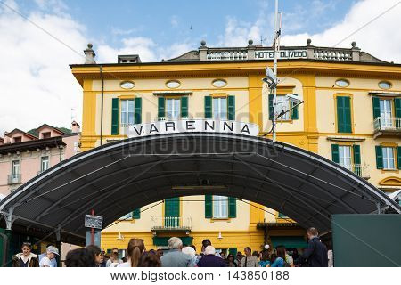 Varenna Italy - May 06 2016: Some people come out of the ferry through the arch in the town