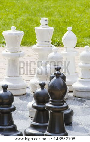 Outdoor giant chess board with big plastic pieces