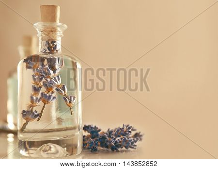 Glass bottles with spa oil and lavender flower, closeup