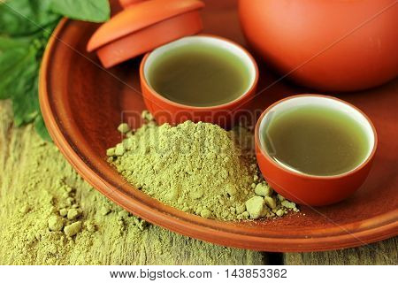 Green tea powder macro and brewed tea in bowls
