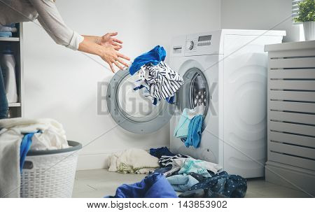 laundry concept. dirty clothes flies into the washing machine