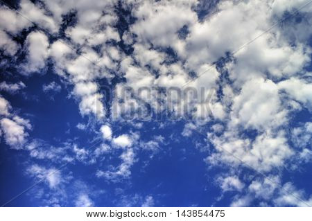 Beautiful background with fluffy clouds on blue sky