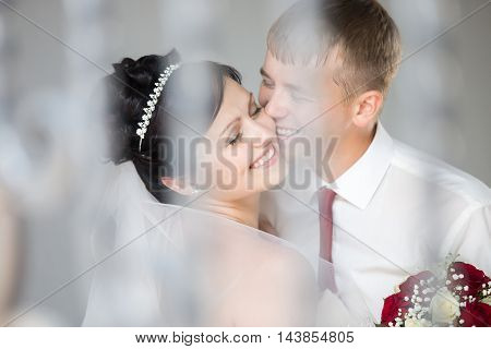 Wedding Couple Laughing And Cuddling