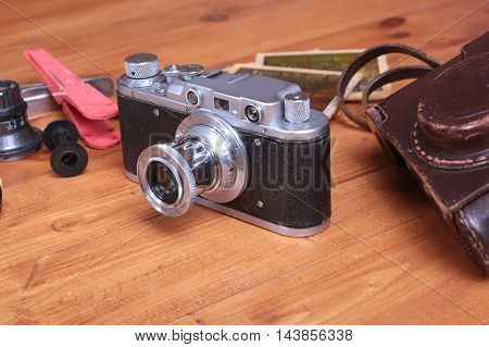 Vintage Camera And Accesoriess On Wooden Background