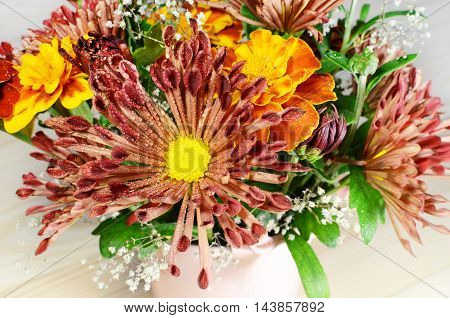 Autumn flowers bouquet with red and yellow chrysanthemum