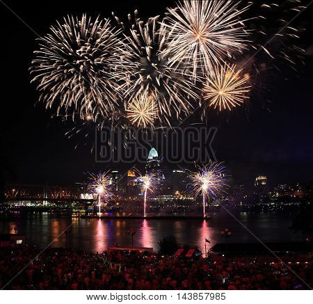 Fireworks bursting over the city of Cincinnati and the Ohio River during the Labor Day celebration 2013 Cincinnati Ohio USA
