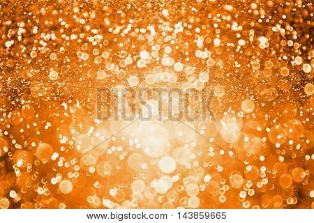 Abstract dark orange glitter sparkle background or party invite for Halloween trick or treat november Thanksgiving or happy birthday texture