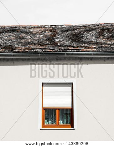 white wall with window and sky no clouds minimalism