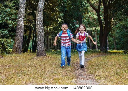 boy and girl running along the path