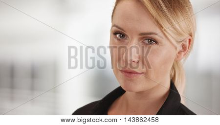 Strong businesswoman manager looking at camera in the office