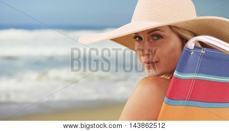 Closeup Of Attractive Woman Sitting By The Beach